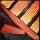 Wooden chairs in the sunshine