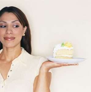 Woman Tempted by Slice of Cake