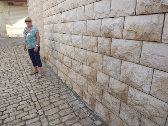 Mom walking along the streets of Cana