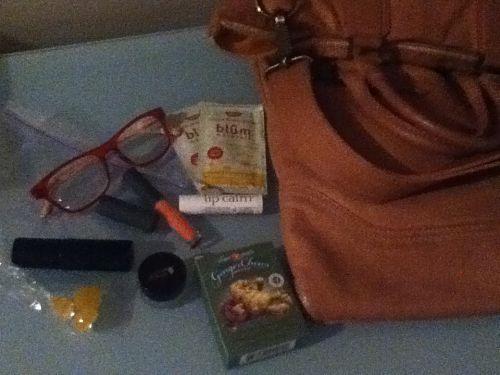 inside Victoria Fantauzzi's purse