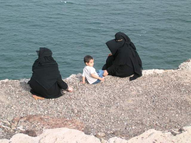 Two women enjoy the beach in Aden, Yemen.