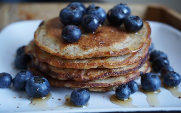Healthy and gluten free banana flaxseed pancakes with blueberries and maple syrup - made with Doves Farm gluten free self-raising flour