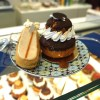 Gluten free salted caramel eclair and chocolate profiterole cake from Helmut Newcake