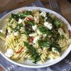Gluten free chilli feta pasta salad with avocado, spinach, spring onions and black olives
