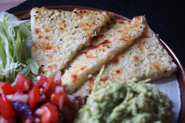 Easy gluten free cauliflower cheese flat bread cut into slices