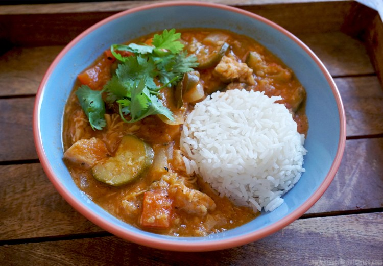 Healthy low carb coconut chicken stew served with rice and fresh coriander