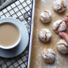 Naturally gluten free amaretti biscuits rolled in icing sugar
