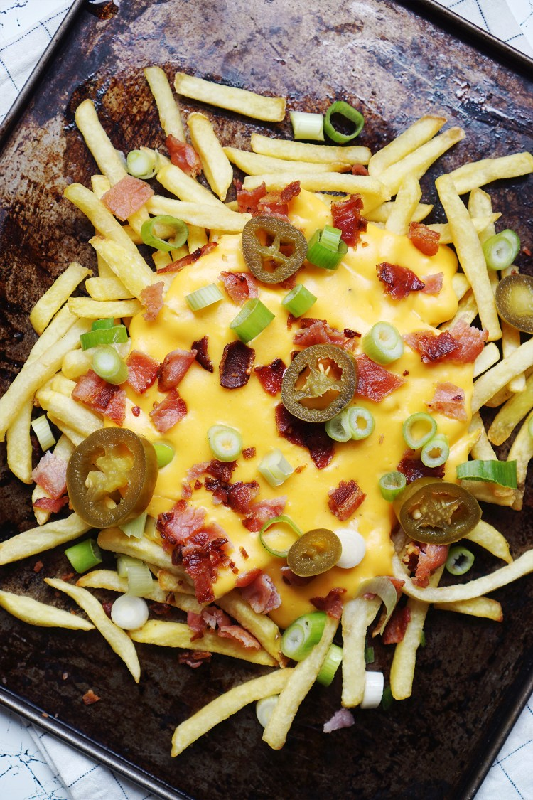 Loaded fries with homemade gluten free cheese sauce, crispy grilled bacon bits, spring onions and jalapeños.