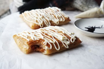 Homemade gluten free toaster strudels with an apple and cinnamon filling + cream cheese icing on top