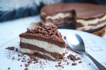 Gluten free layered chocolate cheesecake served with crumbled aero milk chocolate on top