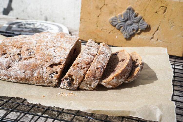 Freshly baked and sliced gluten free rustic cinnamon raisin bread
