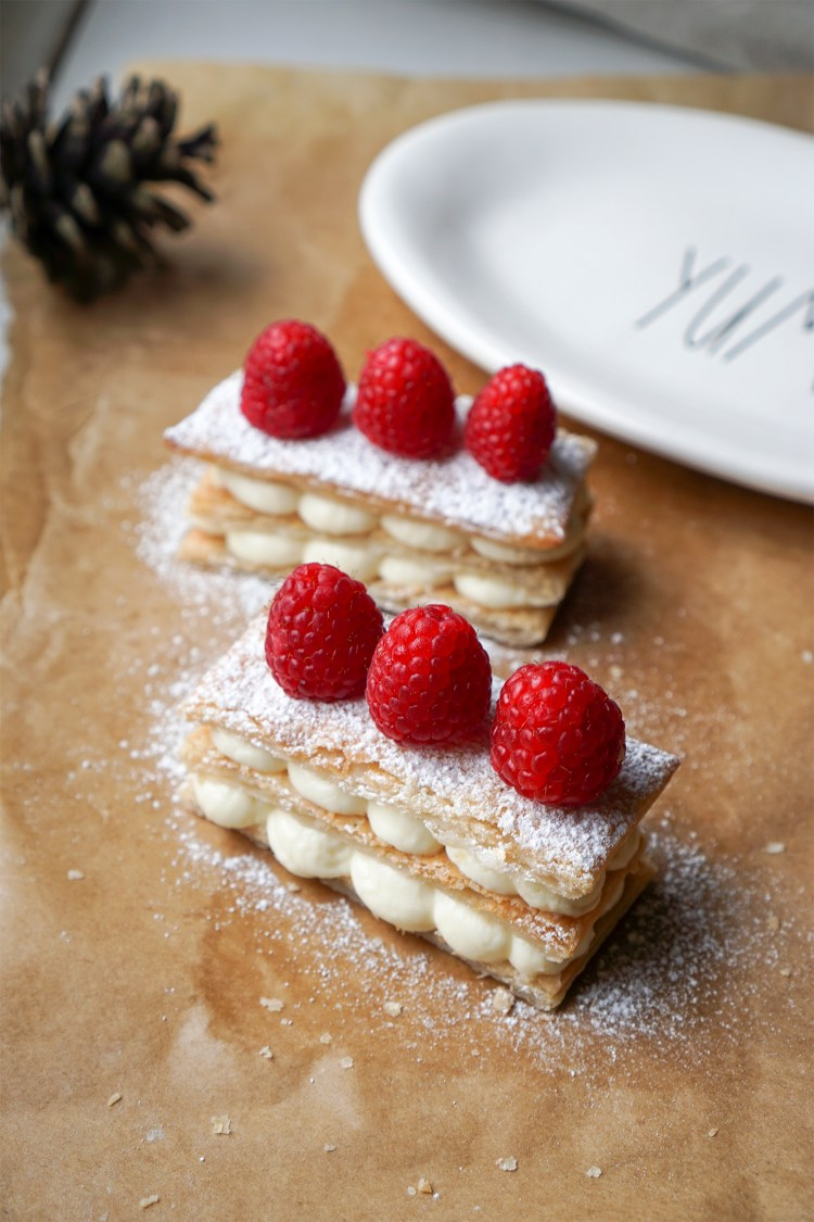 Simple and easy cream cheese mille feuille with a sprinkle of icing sugar and raspberries on top, made with Jus Rol gluten free puff pastry