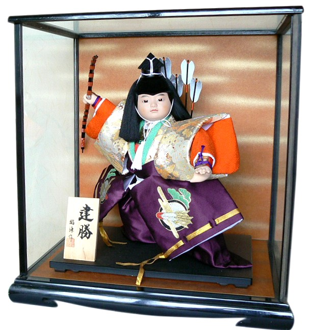 Japanese doll of a young samurai with bow Japanese Dolls