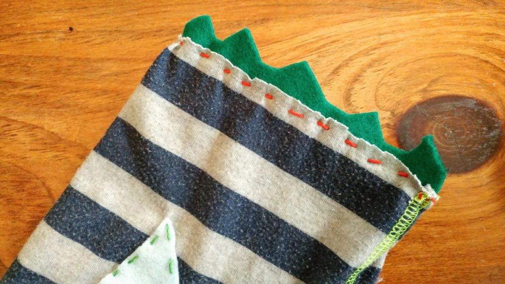Felt scales at the end of a pillow upcycled from pajama pants – http://kimwerker.com/blog