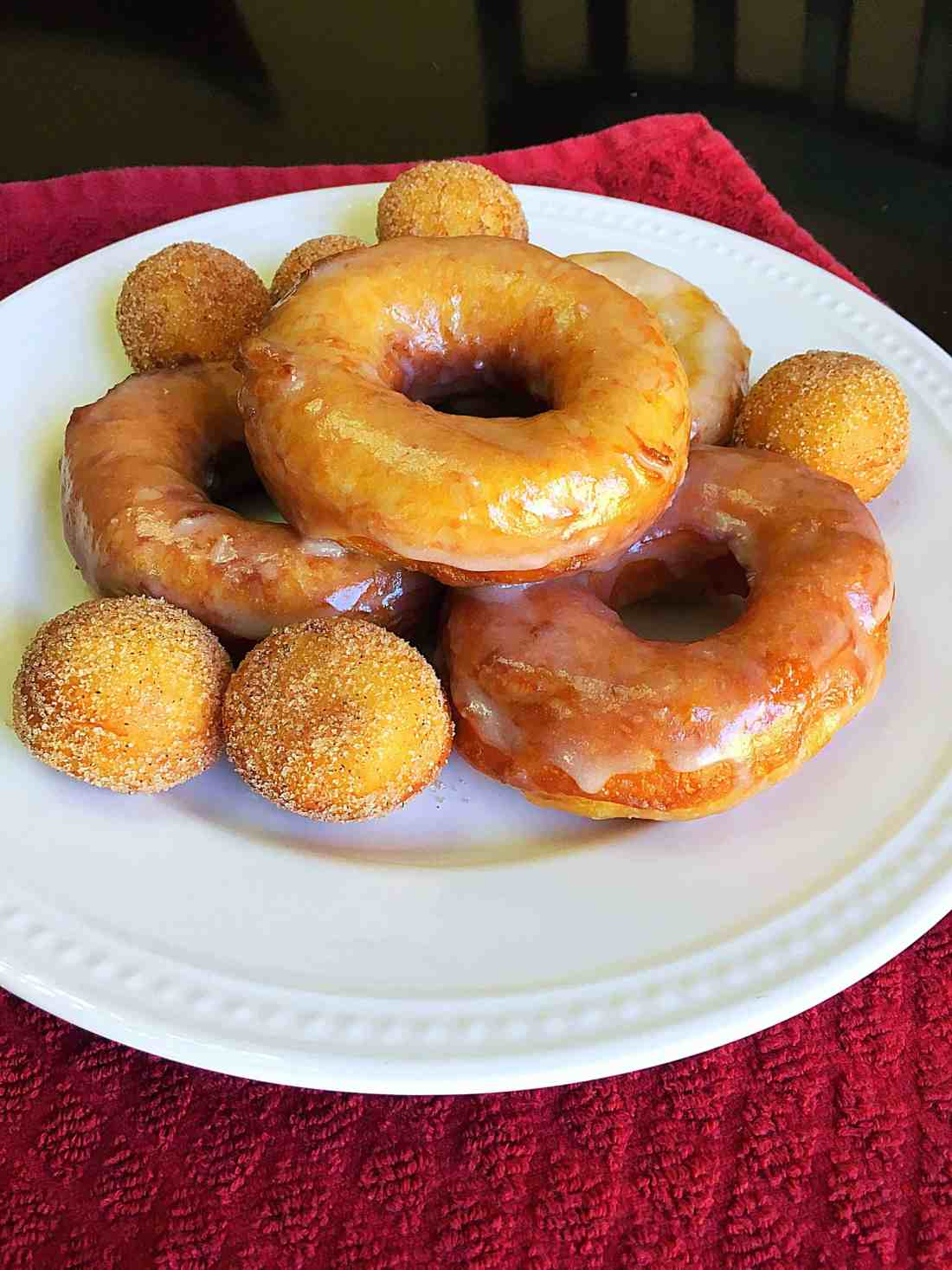 Mouthwatering Biscuit Donuts- These easy-to-make glazed doughnuts are made from canned biscuits and are absolutely mouthwatering! Trust me, you won't be able to eat just one of these yummy biscuit donuts and they only take just a few minutes to make!
