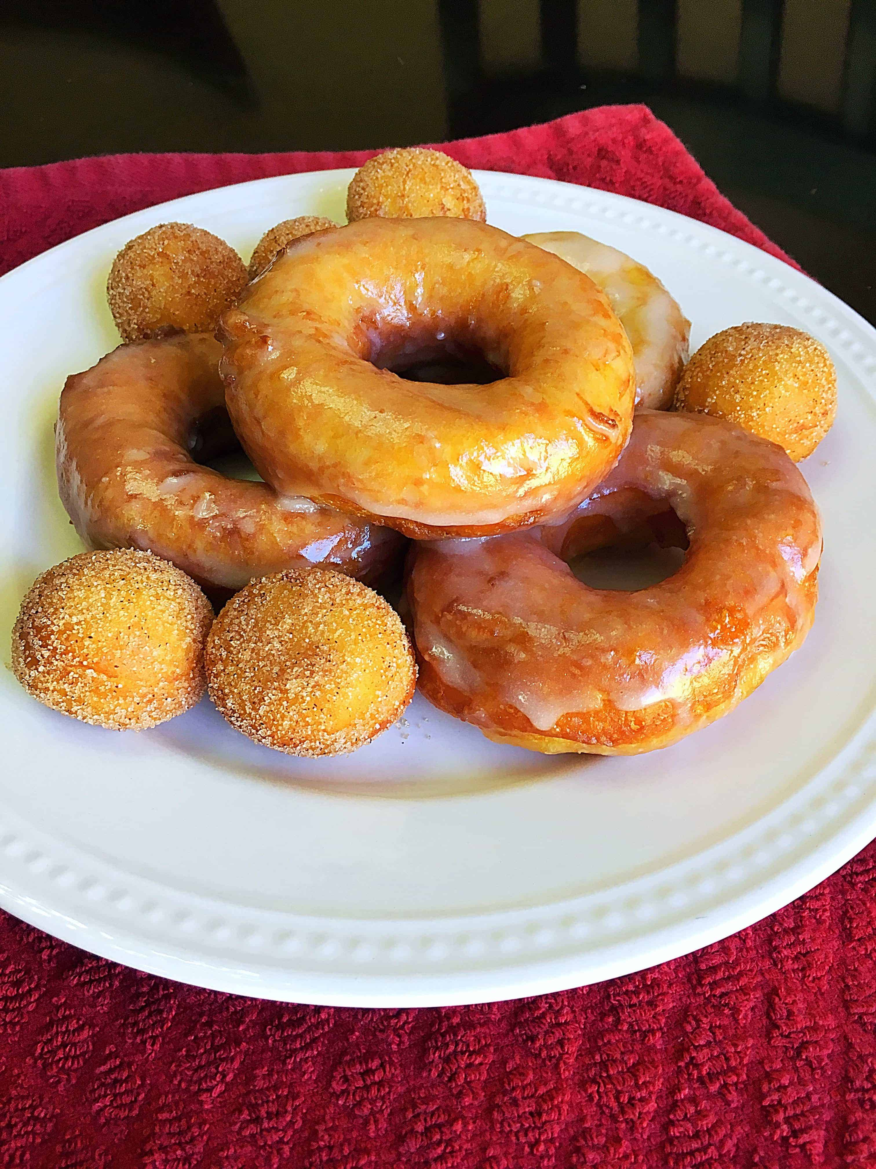 Mouthwatering Biscuit Doughnuts- These easy-to-make glazed doughnuts are made from canned biscuits and are absolutely mouthwatering! Trust me, you won't be able to eat just one of these yummy biscuit doughnuts and they only take just a few minutes to make!