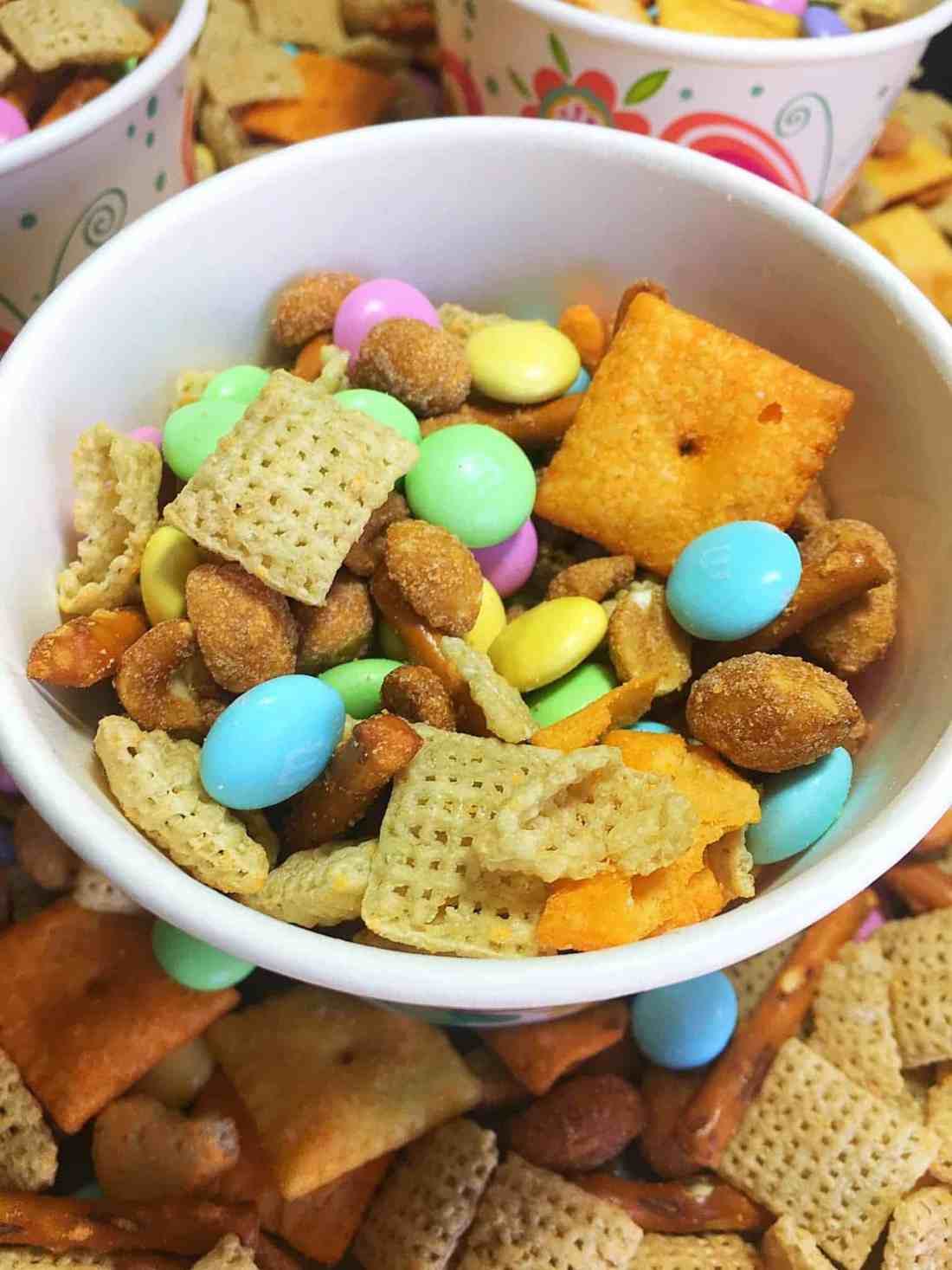 This delicious and easy Springtime Sweet and Salty Chex Mix is the best of both worlds! Featuring sweet flavors from m&m's and honey roasted peanuts, and salty flavors from a cheddar cheese mix, you'll quickly become addicted to this tasty chex mix dessert recipe that takes only 5 minutes to make!