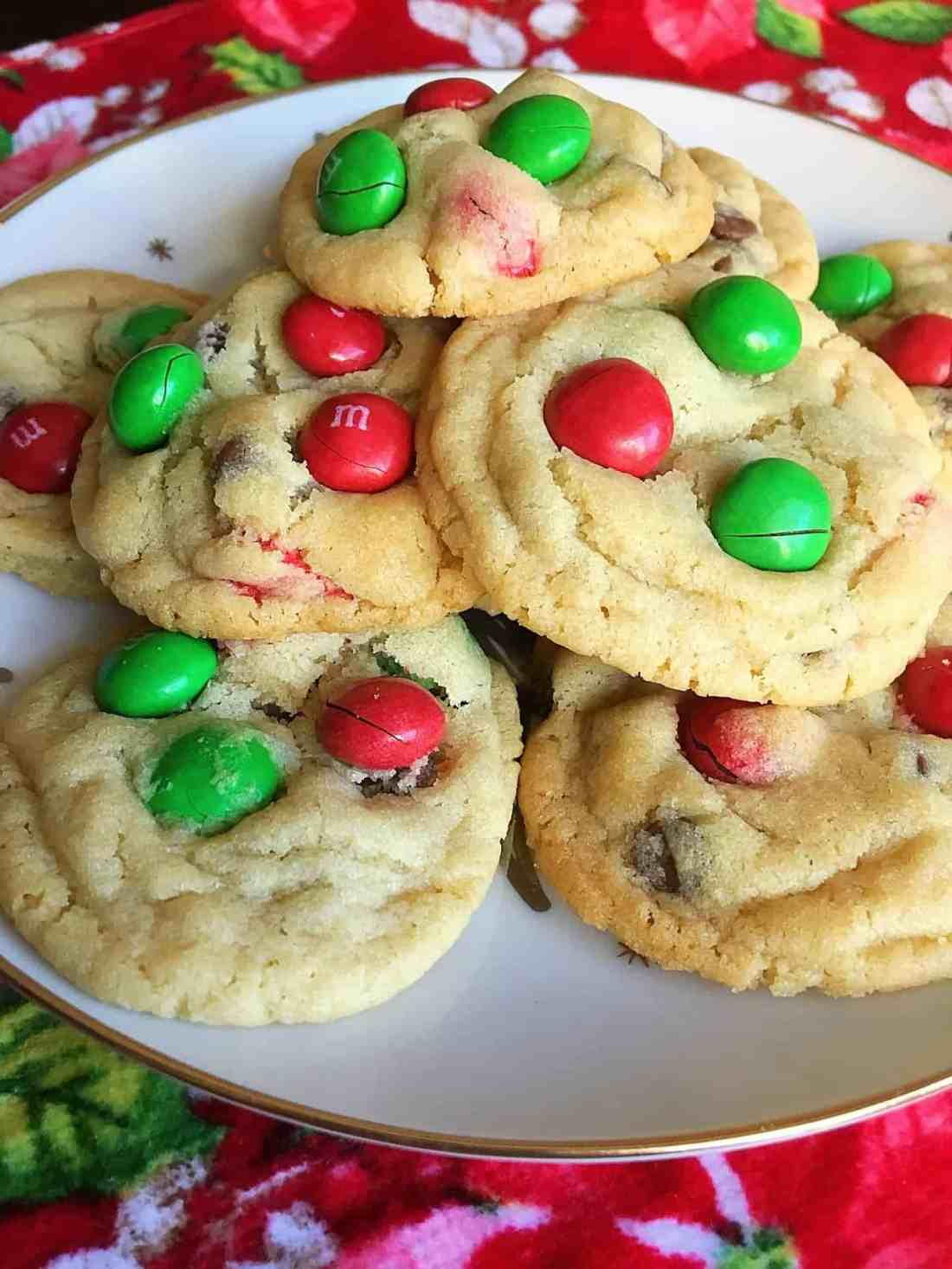 These Magical Peanut Butter M&M Christmas Cookies are the perfect Christmas cookies for family Christmas parties or for Santa! Chocolate chips and peanut butter M&M candies make them extra delicious! #christmascookies #m&m #cookies #christmasdessert