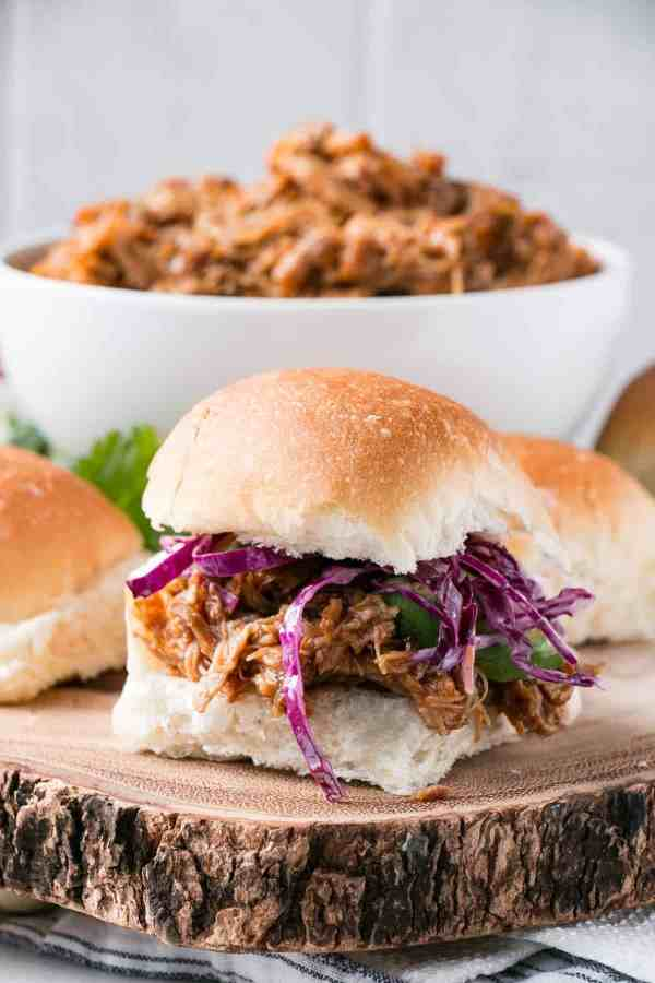 Best BBQ Slow Cooker Pulled Pork | Need food recipe ideas that everyone will love to eat at your next Super Bowl party? Check out my roundup of the 65 Best Super Bowl Party Food Recipes including easy and delicious appetizers, wings, dips, snacks, desserts, and more! #superbowl #partyfood #superbowlfood