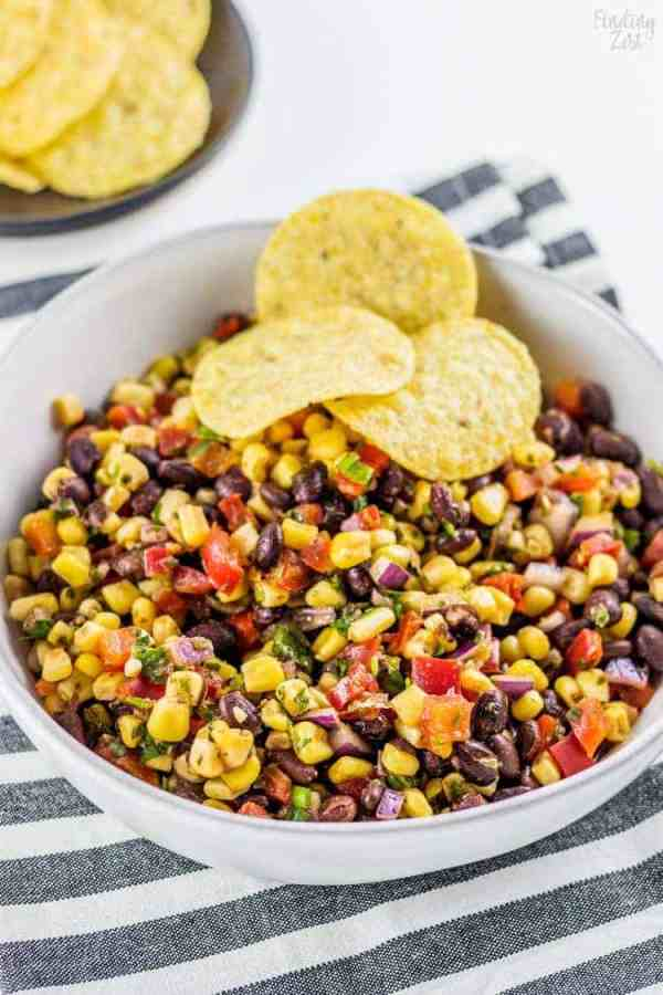 Black Bean Corn Salsa | Need food recipe ideas that everyone will love to eat at your next Super Bowl party? Check out my roundup of the 65 Best Super Bowl Party Food Recipes including easy and delicious appetizers, wings, dips, snacks, desserts, and more! #superbowl #partyfood #superbowlfood