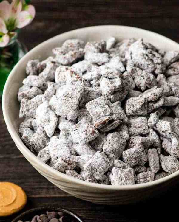 Easy Puppy Chow | Need food recipe ideas that everyone will love to eat at your next Super Bowl party? Check out my roundup of the 65 Best Super Bowl Party Food Recipes including easy and delicious appetizers, wings, dips, snacks, desserts, and more! #superbowl #partyfood #superbowlfood