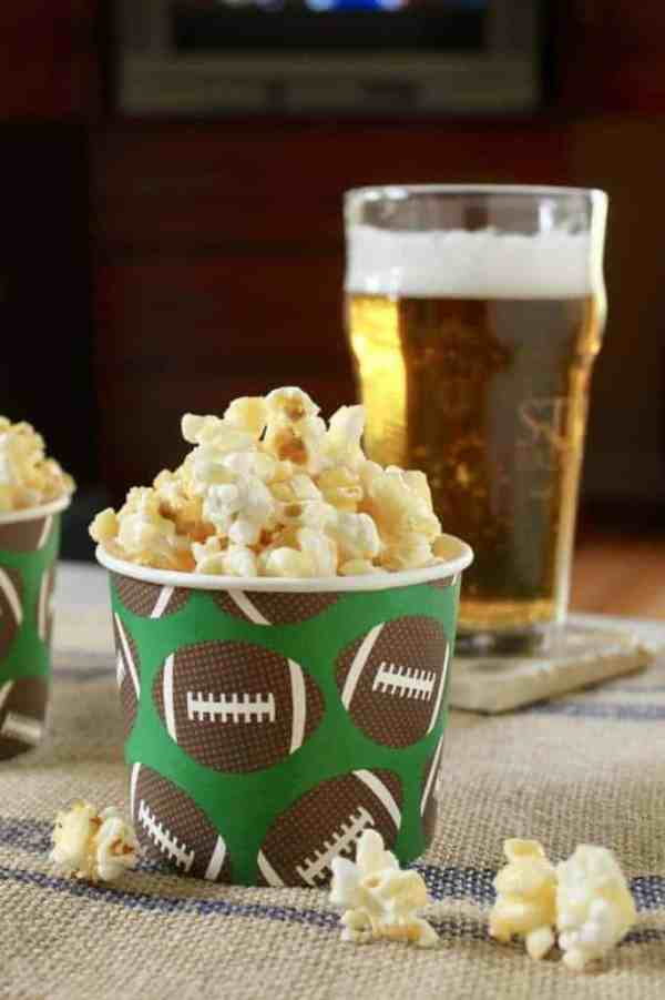 Caramel Crunch Popcorn | Need food recipe ideas that everyone will love to eat at your next Super Bowl party? Check out my roundup of the 65 Best Super Bowl Party Food Recipes including easy and delicious appetizers, wings, dips, snacks, desserts, and more! #superbowl #partyfood #superbowlfood