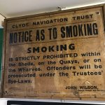 No Smoking sign and an old school poster of the Clyde docks, 1950s.