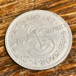 Sigg aluminium advertising token for HF Nicholls, Gallowgate, Glasgow.