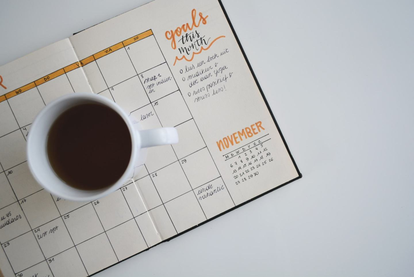 photo of a planner showing set goals good habits for switching up your life