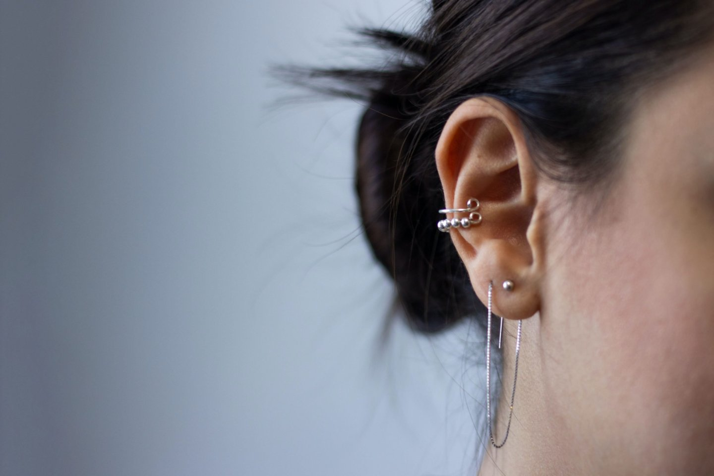 Photo showing Ear piercings as accessories