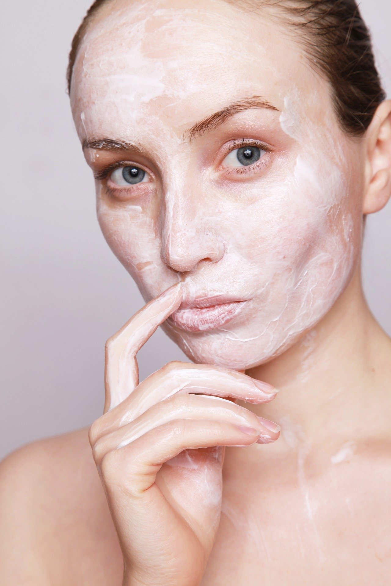 woman with white facial mask on
