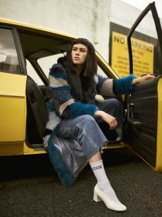 Isobella wears faux fur patchwork coat - Clio Peppiat | Jeans - Rokit | Socks - Model's own | Shoes - McQ