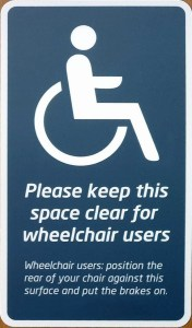 "Sign: ""Please keep this space clear for wheelchair users"""