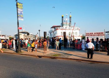 Residents gather to board a part boat in Sheepshead Bay. Photo courtesy of City Councilmember Chaim Deutsch's office.