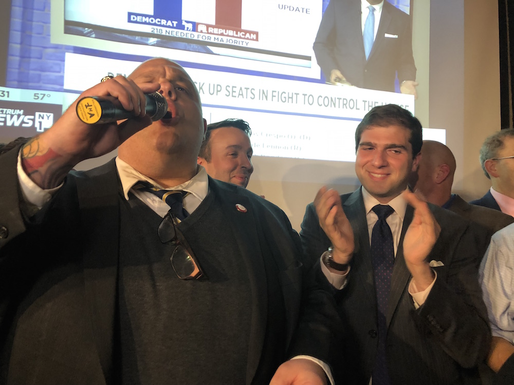 City Council Member Justin Brannan, a rising powerhouse in the Democratic Party ranks speaks up as Sen.-elect Andrew Gounardes, right, applauds during his victory party last night. Photo by Kelly Mena.