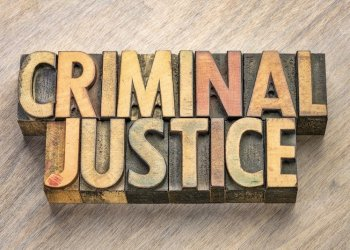 criminal justice word abstract in vintage letterpress wood type