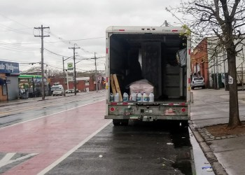 A coffin and bottles of bleach in the back of a U-Haul truck outside Andrew T. Cleckley's Funeral Home, 2037A Utica Avenue in Flatlands. Photo by Ariama Long.