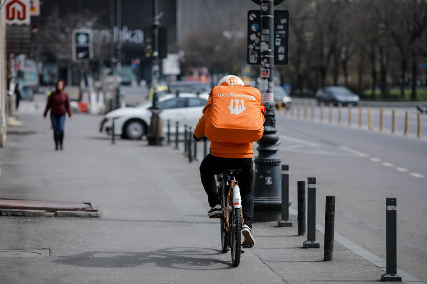 Bucharest, Romania - March 28, 2020: Takeaway delivery in downtown Bucharest during the covid-19 lockdown.