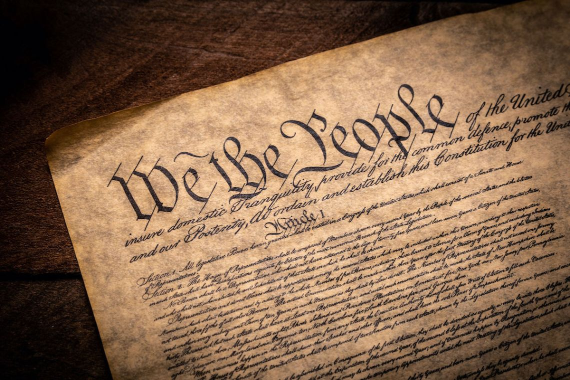A copy of the Constitution of the United Sates of American on a wooden background. 123rfPhotostock