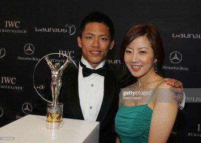 ESTORIL, PORTUGAL - MAY 16: Judo star Tadahiro Nomura and guest pose with the Laureus trophy during the Laureus World Sports Awards on May 16, 2005 at the Estoril Casino, Estoril, Portugal. (Photo by David Cannon/Getty Images for Laureus) *** Local Caption *** Tadahiro Nomura