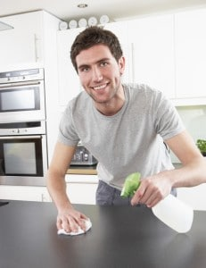 Man cleaning kitchen counter