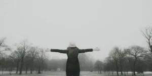feeling festive - lady outside in snowy park