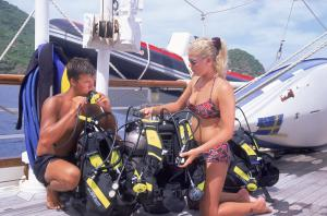Couple on deck with scuba equipment