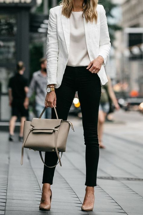 Model showing ivory blazer worn with classic black slim trousers