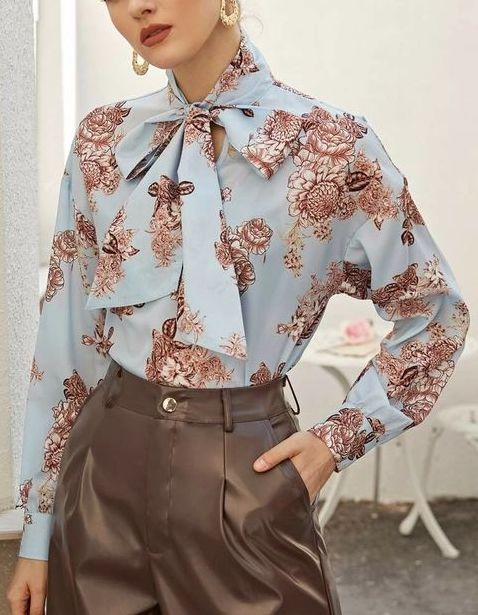 Model showing a printed blouse that fits the smart casual ideal
