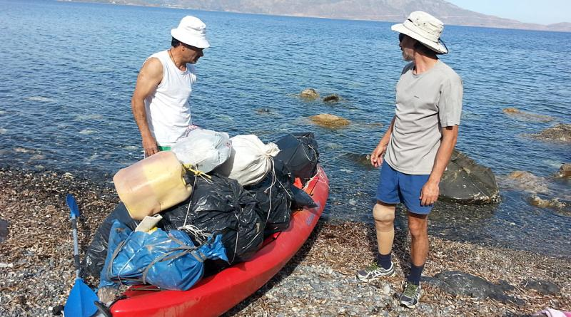 Kayak loaded with rubbish