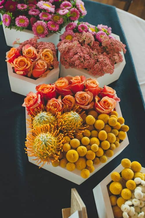 Sometimes, Home Depot has planters that are so stunning - you can just stuff them full of flowers and let them be the focal point on your reception tables!