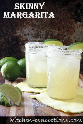 mason jar with margarita and lime on the rim