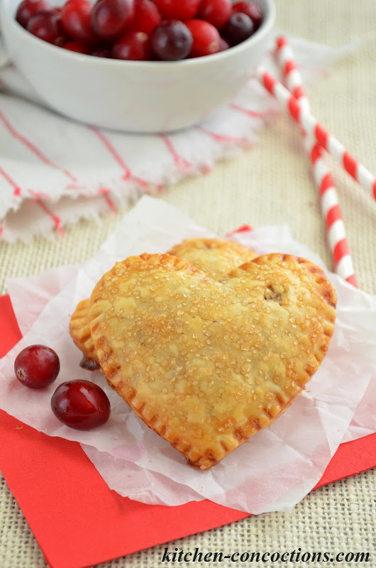 Valentine's Dessert Recipe - Mini Heart Shaped Cranberry Hand Pies from Kitchen Concoctions