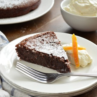 Flourless Chocolate Cake with Orange Whipped Cream and Candied Orange Peel